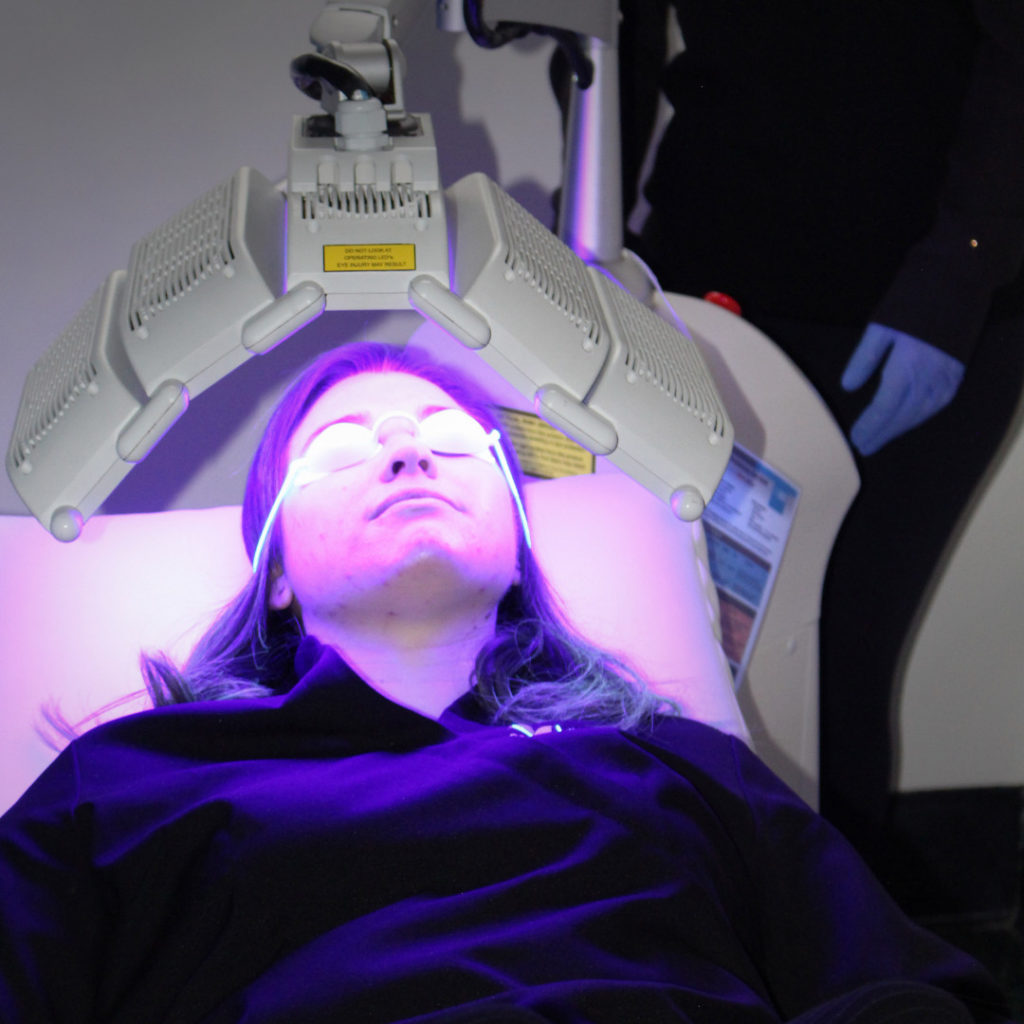 a patient receiving blue light phototherapy at Victoria's Cosmetic Medical Clinic