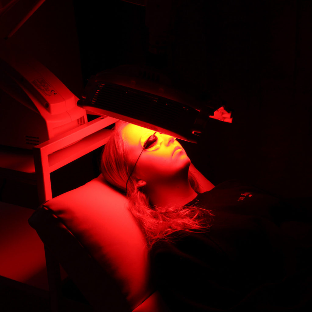 patient receiving red light phototherapy for skin rejuvenation at Victoria's Phototherapy Clinic